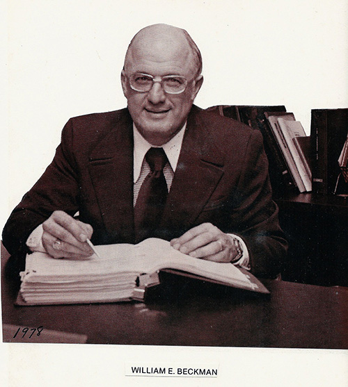 image of William E Beckman at his desk